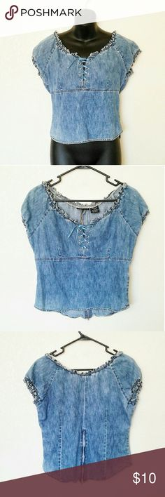Vintage Lace Up Top Denim top. Has a zipper half way up the back. The sting can be replaced. Some wear around the metal pieces where the string goes through (pictured).  Brand: Unknown Size: Medium Condition: flaws mentioned above. Great condition other than that.  #denim #denimvintage #vintage #denimtop #denimshirt #laceup #laceupshirt #summer #summerfashion #summerstyle #style #fashion #cheap #styleforcheap #bundleandsave #xoxopf Vintage Tops Blouses