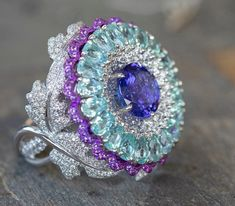 """Mona on Instagram: """"-TANZANITE- The color hue of tanzanite are blue and violet. Untreated tanzanite is a trichroic gemstones, meaning that light that enters…"""" Chopard, High Jewelry, Hue, Heart Ring, Sapphire, Gemstones, Rings, Instagram, Color"""