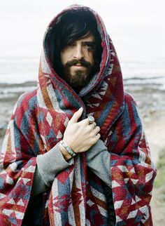 Sexy, beardy hippie guy lookin all comfy and cozy.