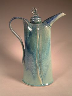 A handmade ceramic teapot would make a great home decor piece