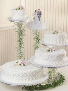 Lace Wedding Cakes Floating Cake Stand: I want to try and make this cake on a floating stand. My guest list is only 150 so I probably won't be needing all 4 tiers. The actual number of guests Bling Wedding Cakes, Wedding Cake Stands, White Wedding Cakes, Elegant Wedding Cakes, Beautiful Wedding Cakes, Wedding Cake Designs, Wedding Cupcakes, Lace Wedding, Wedding Flowers