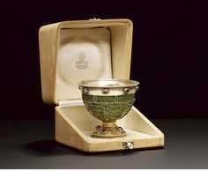 A jewelled silver-gilt mounted nephrite cup  by Fabergé and with the workmaster's mark of Feodor Afanasiev, St. Petersburg, 1908-1917, with scratched inventory number 23104  in original fitted wood box, the interior cover stamped in Russian 'Fabergé St. Petersburg Moscow, London' with the Imperial warrant.