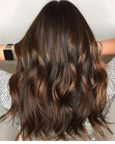 Stunning shiny brunette balayage waves by Aveda Artist Izzet Tabak of Turkey.