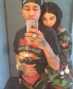 Tyga cuddling with Kylie Jenner while taking a selfie