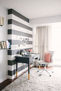 The striped wall makes a perfect focal point for this home office! I also love the built in bookshelves that seem to float on the walls!