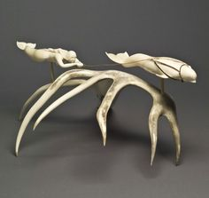 Looty Pijamini - Grise Fiord, Lumak Legend, 1991.  - Ivory, antler, sinew. Collection of The Winnipeg Art Gallery.  Gift of Dr. Harry Winrob. 2006-621. 1 to 5
