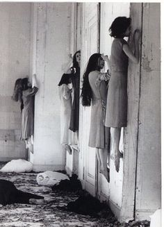 Looks freaky, but if you look closely, they each have their left foot on a window ledge being hidden by their right foot!