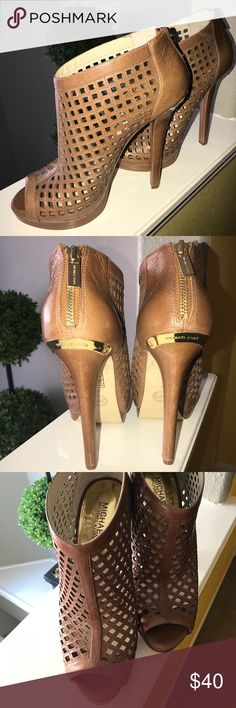 Michael Kors High Heel Sandals 👡 👡 It brings me great sadness to post these heels 😢 I bought from a fellow posher but there is no way my foot fits in them. I am a size 9 (wide feet) and I would need a miracle to get these on and zipped up. I paid exactly 40.00 so I'm just trying to get my money back. Please beware this is a narrow shoe and like I said I would have loved to have kept it in my collection especially with spring & summer around the corner. Michael Kors Shoes Heels