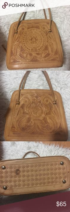 Vintage Mexican Tooled Leather Hand Bag This is the most unique bag I own. And I love it, however I haven't used it much because it is quite delicate (and I go to school with heavy books) so I don't want to damage it. I'm opened to offers just no low balling! As you can see from the pics it's been preloved from the previous owner but still beautiful as ever! Any questions please ask before purchase. Vintage Bags Shoulder Bags