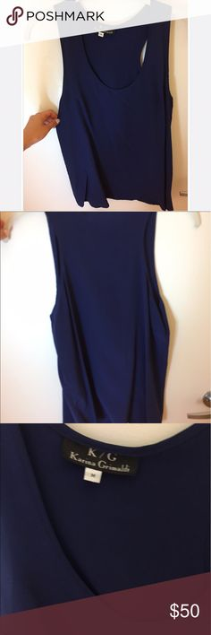 KARINA GRIMALDI blouse Gorgeous navy blouse in great condition. Size M & runs true to size. Leave a comment if you would like me to model it or post more photos! Originally $225- brand can be found on Neiman Marcus, Saks, etc. Karina Grimaldi Tops Blouses