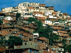 Caracas, Venezuela -- I remember seeing these homes, built into the hillsides.   Such a crowded place and some very poor people.  Made me appreciate life in the US.