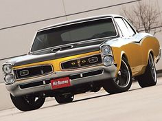 1966 Pontiac GTO ( Basically the same style as my '67 GTO, except the grill on my car was silver and my car was Red with a Black Vinyl top.  This 2 tone paint was not a standard color - solid gold was, or gold w/ a Black Vinyl top, | http://awesomesportcarscollections.13faqs.com
