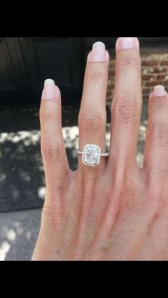 Elongated radiant with a fine halo and micro pave band - beautiful! D colour 1.91 Carat