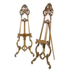 A near pair of French carved stained beech easels circa 1870