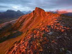 Blåfjellet peak illuminated by brilliant Arctic sunset light. This mountain is located near the tiny town ofKjerringøy, which is just north of the city of Bodø, in northern Norway.