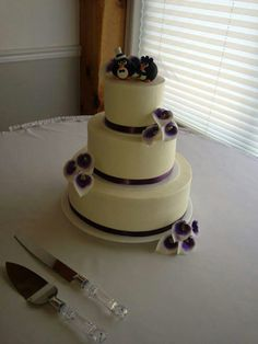 This Wedding Cake Was Simply Adorned With A Purple Satin Ribbon And Gumpaste Calla Lilies