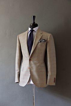 Brown and blue gun check blazer, white shirt, navy tie, silk pocket square