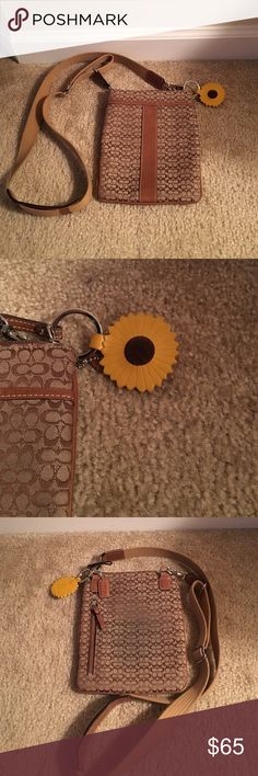Brown coach cross body Coach cross body purse. Small discolored area on back due to rubbing on pants. Sunflower key chain not included. Coach Bags Crossbody Bags