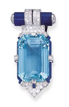 AN ART DECO AQUAMARINE, DIAMOND, LAPIS LAZULI AND ENAMEL CLIP, BY CARTIER Set with a rectangular-cut aquamarine, held by single-cut diamonds, within a blue enamel frame enhanced by a diamond-set and enamel palmette terminal, to the lapis lazuli tubular top with single-cut diamond detail, circa 1925 Signed Cartier.