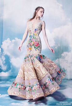 This fashion-forward mermaid gown from Nicolas Jebran featuring colorful floral embroideries is a show stopper! » Praise Wedding Community