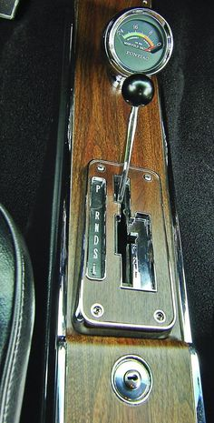 "67 GTO's FAMOUS ""DUAL GATE"" Shifter with the OEM vacuum gauge in displaying driving performance!"