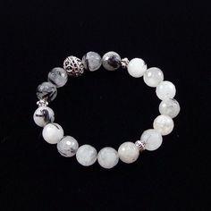 Tourmalinated Quartz Bracelet.    Hand-cut and faceted Tourmalinated Quartz 10mm beads and Antiqued silver filigree Pewter bead on Elastic cord.