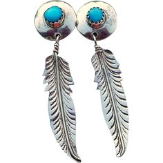 Vintage Native American Turquoise And Sterling Silver Feather Post Earrings Vintage estate sterling silver post earrings have turquoise stones set into serrated bezels on sterling silver discs. Hanging from the bottom are dangling feathers with veined detail. The feathers have very nice movement and the earrings are surprisingly light weight. The post is approx 12mm. It should fit on your earlobe nicely. The total length is 1 3/4 inches. Excellent condition