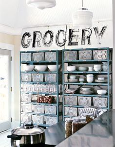 Love the Grocery sign!! Construct a pantry from a pair of metal storage shelves. This one is painted blue with individual metal bins taking the place of drawers; labels placed on the shelves help identify the bins' contents.    Read more: Kitchen Storage - Storage and Organization Ideas for Efficient Kitchens - Country Living
