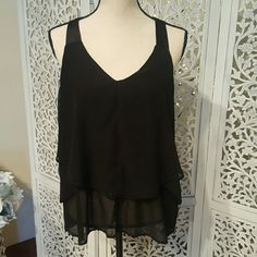 Jessica Simpson Tiered embellished tank top blouse This blouse has a tiered design with silky like straps. Each tier is lined at the bottom with black rhinestones. Jessica Simpson Tops Blouses
