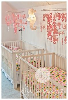 This pink and yellow seahorse decor is perfect for a seaside cottage-themed nursery for twins. #nurseryideas #twinsnursery #twins