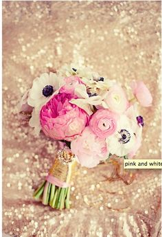 Pretty pink and white floral bouquet wrapped in metallic gold tape