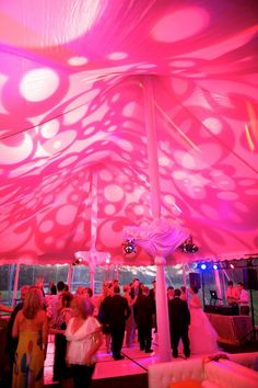 Pink and playful! The Kate Spade inspired dancing tent on Northport Point was the perfect after dinner fun! The dancing tent was decked in white pintuck leather furnishings, shimmer gold linen and hot pink accents. Jen Kroll Photography. A Day in May Events. Special Events Rental.