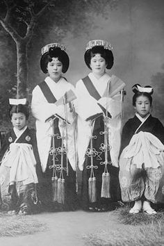 Japanese Mothers with Their Children wear traditional Kimono with Obi & hair combs