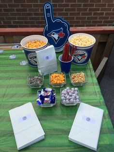 Concession stand complete with Caramel covered popcorn, butter popcorn, Baby Ruth mini chocolates, peanuts, sunflower seeds and baseball chocolates