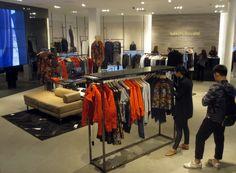 Karen Millen,  fall '14 collection in london knightsbridge flagship targeting affordable luxury segment