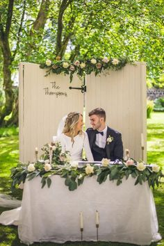 This couple's al fresco ceremony site featured a romantic door backdrop adorned with garden roses and assorted foliage. Photo: NavyBlur Photography