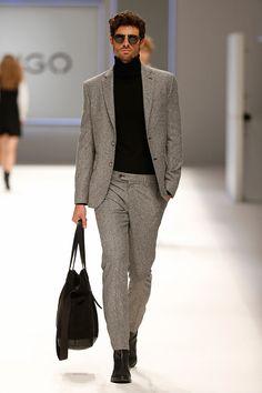 Grey suit. Black wool turtleneck. Leather bag. Mango Fall/Winter 2015