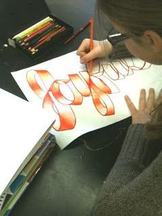 I've done this lesson using artist Ed Ruscha's graphite drawings of ribbon words for inspiration. We got great results!