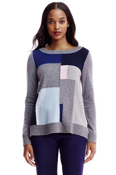 This cozy pullover sweater is fresh and distinctive in multi-color patchwork.