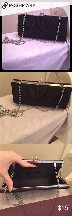 Black satin clutch/purse Black satin clutch purse or cross body perfect for weddings or other formal events. Perfect condition. Interior with ID and credit card slots. Strap may be completed detached if desired to use solely as clutch. Charming Charlie Bags Clutches & Wristlets