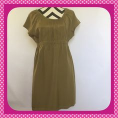 J CREW LIGHTWEIGHT SHORT SLEEVE DRESS J CREW shirt sleeve light weight dress with shirt sleeve dress. Elastic waist band and neckline.  Lined skirt. Size Large...55% Silk 45% Cotton. Very good condition with exception of pinholes at top back...enlarged for photo #3. J. Crew Dresses