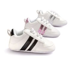 Set your baby up to be a runner! These adorable soft soled baby sneakers come in three metallic colors: white, black, and pink, as well as three sizes: 1, 2, and 3. Elasticized shoe laces and all arou
