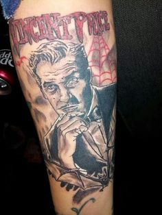 Vincent Price.    Done by:Juan L. Chavez Houston, Tx      Yes this is my (Liz) tattoo.