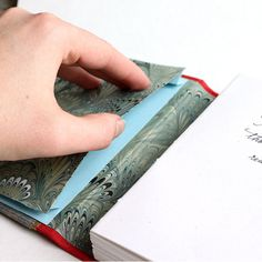 a secret pocket in the end pages of this handmade travel journal by Ruth Bleakley