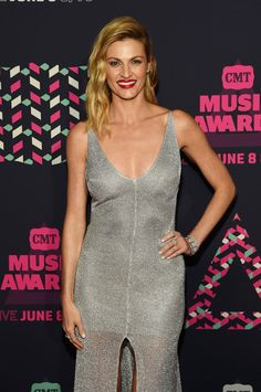 Erin Andrews Photos Photos - Host Erin Andrews attends the 2016 CMT Music awards…