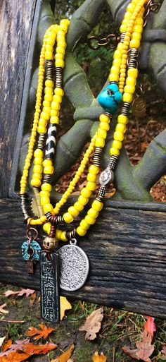 Kianga: African Inspired Tribal Yellow Glass and Mixed Media Pendant Necklace $275