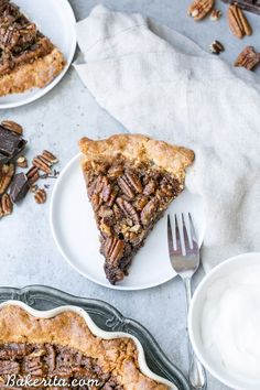 This Paleo Chocolate Pecan Pie has a flaky grain-free pie crust and a layer of chocolate ganache! This gluten-free and refined sugar-free pie is gooey, crunchy, and the perfect addition to your holiday dessert line-up.