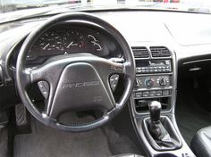 did not have a single cupholder. was so annoying! Mazda Capella, Ford Probe Gt, Ford America, Cars Usa, Rear Wheel Drive, Interior Photo, Ford Motor Company, Ford Gt, Motor Car
