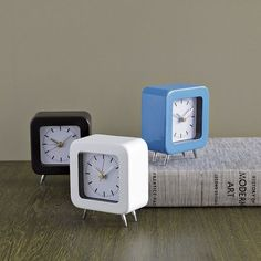 Colored Metal Footed Clock   west elm  To keep track of time while getting dressed.