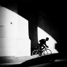 Racing Shadows #brisbane #bicycle #bikerider #shadow#kangaroopoint #racing#mobiography #theappwhisperer #hipstamatic #storeybridge #blackandwhite by wayneg_263